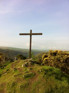 Picture of the HIgh Cross at the retreat centre at Ffald-y-Brenin, looking from there across the landscape of distant hills