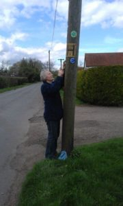 Lorie Lain-Rogers fixes a waymarker on Ash Lane, Carleton Fen.